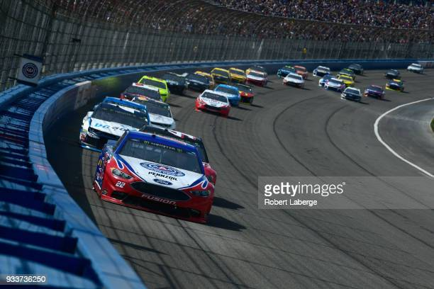 Joey Logano driver of the AAA Southern California Ford leads a pack of cars during the Monster Energy NASCAR Cup Series Auto Club 400 at Auto Club...