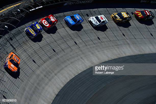 Joey Logano driver of the Autotrader Ford leads a pack of cars during the NASCAR Sprint Cup Series Food City 500 at Bristol Motor Speedway on April...