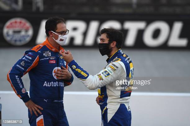 Joey Logano driver of the Autotrader Ford talks with Chase Elliott driver of the NAPA Auto Parts Chevrolet after the NASCAR Cup Series Food City...