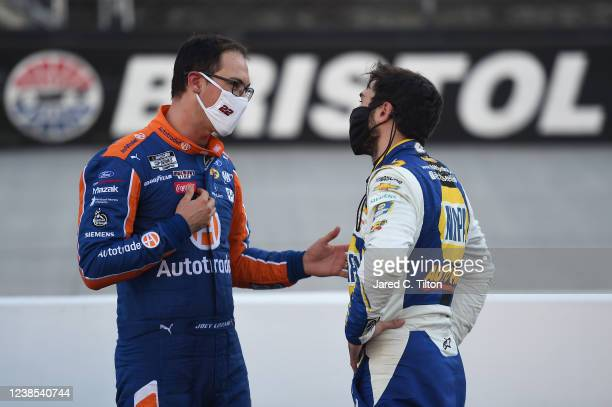 Joey Logano, driver of the Autotrader Ford, talks with Chase Elliott, driver of the NAPA Auto Parts Chevrolet, after the NASCAR Cup Series Food City...