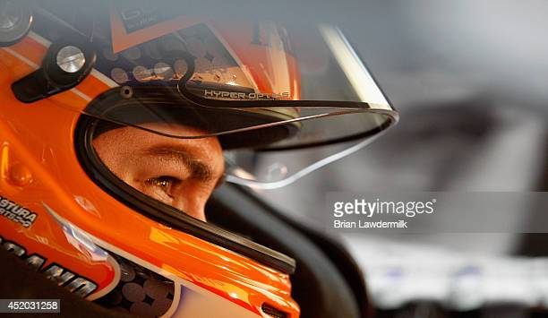 Joey Logano, driver of the AutoTrader.com Ford, sits in his car in the garage area during practice for the NASCAR Sprint Cup Series Camping World RV...