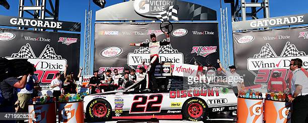 Joey Logano, driver of the Discount Tire Ford, celebrates in Victory Lane after winning the NASCAR XFINITY Series Winn Dixie 300 at Talladega...