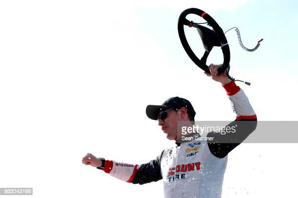 Joey Logano driver of the Discount Tire Ford celebrates in victory lane after winning the NASCAR Xfinity Series Roseanne 300 at Auto Club Speedway on...