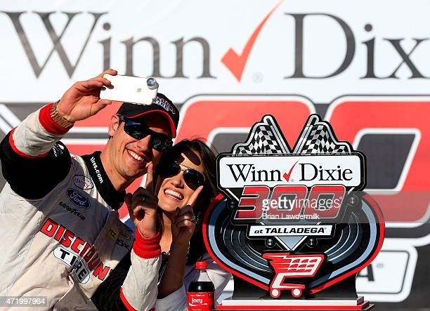 Joey Logano driver of the Discount Tire Ford celebrates with his wife Brittany after winning the NASCAR XFINITY Series Winn Dixie 300 at Talladega...