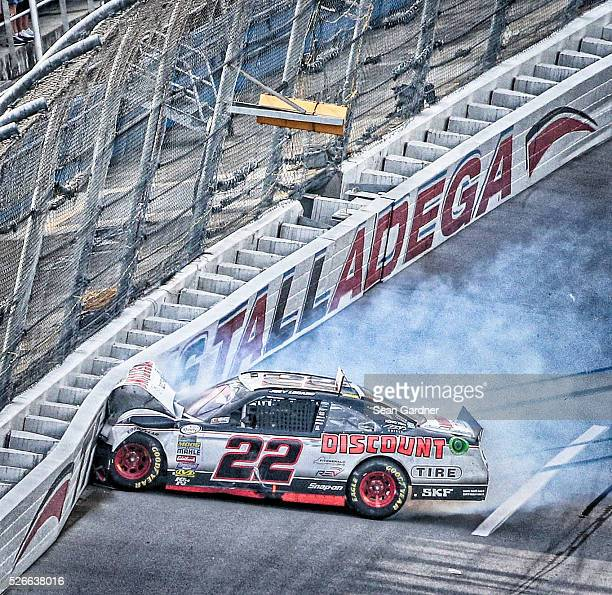 Joey Logano driver of the Discount Tire Ford hits the wall after an on track incident with Elliott Sadler driver of the OneMain Chevrolet in the...
