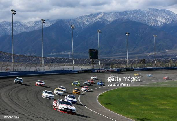 Joey Logano driver of the Discount Tire Ford leads the field during the NASCAR Xfinity Series Roseanne 300 at Auto Club Speedway on March 17 2018 in...
