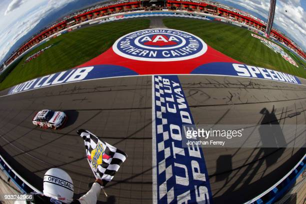 Joey Logano driver of the Discount Tire Ford races to the checkered flag to win the NASCAR Xfinity Series Roseanne 300 at Auto Club Speedway on March...