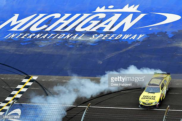 Joey Logano driver of the Dollar General Toyota celebrates his win with a burnout after the NASCAR Nationwide Series Alliance Truck Parts 250 at...