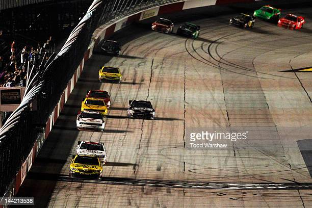 Joey Logano driver of the Dollar General Toyota crosses the finish line to win the NASCAR Nationwide Series VFW Sport Clips Help A Hero 200 at...