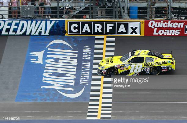 Joey Logano driver of the Dollar General Toyota crosses the finishline to win the NASCAR Nationwide Series Alliance Truck Parts 250 at Michigan...