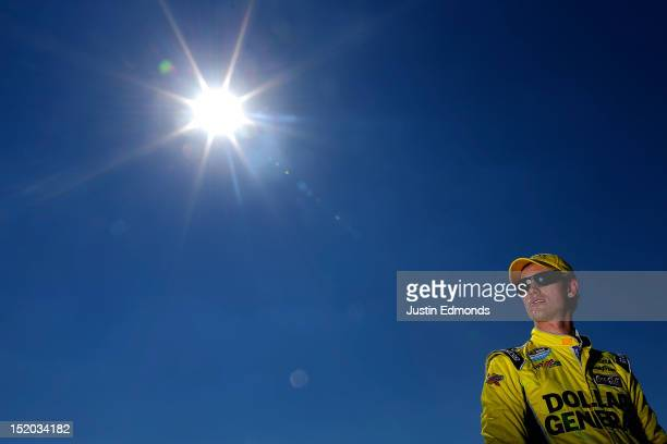 Joey Logano driver of the Dollar General Toyota looks on during qualifying for the NASCAR Sprint Cup Series GEICO 400 at Chicagoland Speedway on...