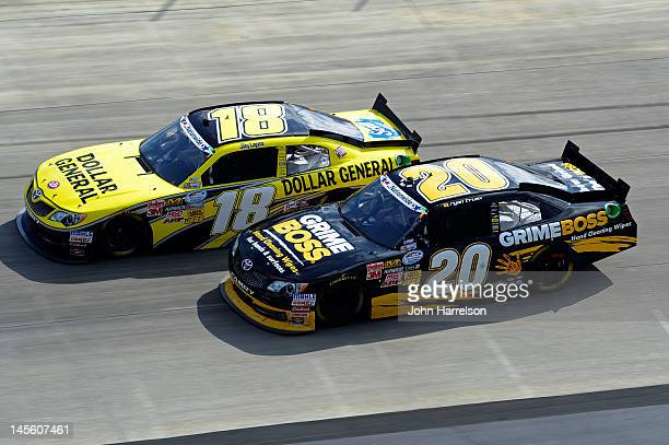 Joey Logano, driver of the Dollar General Toyota, passes Ryan Truex, driver of the Grime Boss Toyota, late in the race on his way to winning the...