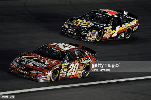 Joey Logano driver of the GameStop Chevrolet races with David Gilliland driver of the Miccosukee Indian Gaming Resorts Chevrolet during the NASCAR...