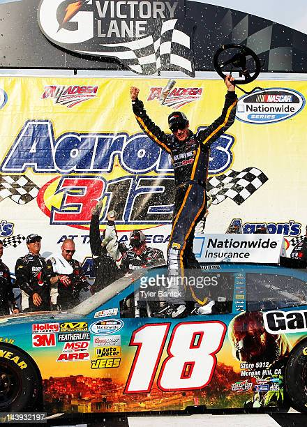 Joey Logano driver of the GameStop Toyota celebrates in victory lane after winning the NASCAR Nationwide Series Aaron's 312 at Talladega...