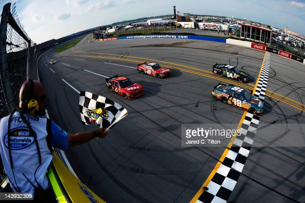Joey Logano driver of the GameStop Toyota crosses the finish line to win the NASCAR Nationwide Series Aaron's 312 at Talladega Superspeedway on May 5...