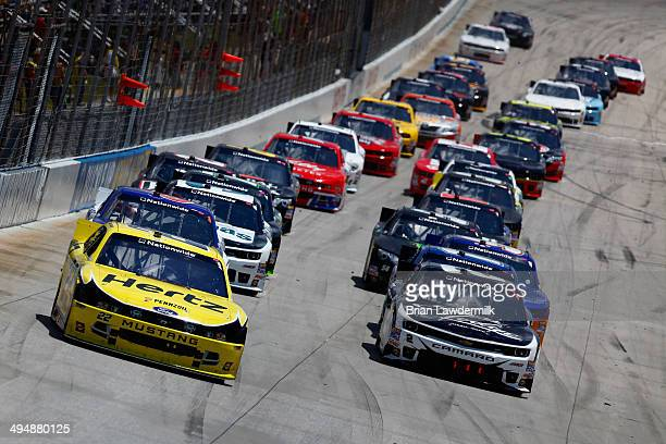 Joey Logano driver of the Hertz Ford and Brian Scott driver of the Shore Lodge Chevrolet lead the field during the NASCAR Nationwide Series Buckle Up...