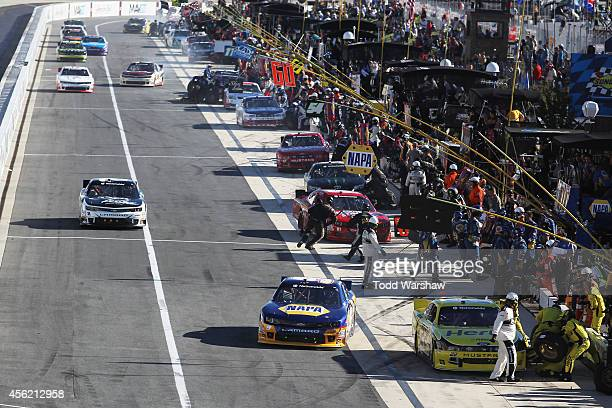 Joey Logano driver of the Hertz Ford and Chase Elliott driver of the NAPA Auto Parts Chevrolet pit during the NASCAR Nationwide Series Dover 200 at...
