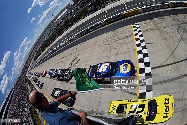 Joey Logano driver of the Hertz Ford and Chase Elliott driver of the NAPA Auto Parts Chevrolet lead the field to the green flag for the start of the...