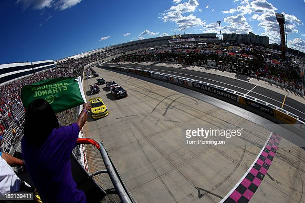 Joey Logano driver of the Hertz Ford and Sam Hornish Jr driver of the SnapOn Ford lead the field to the green flag to start the NASCAR Nationwide...