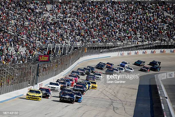 Joey Logano driver of the Hertz Ford and Sam Hornish Jr driver of the SnapOn Ford lead the field at the start of the NASCAR Nationwide Series 5Hour...