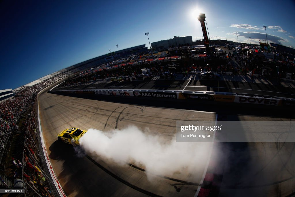 Joey Logano, driver of the #22 Hertz Ford, celebrates with a burnout after winning during the NASCAR Nationwide Series 5-Hour Energy 200 Benefiting Living Beyond Breast Cancer at Dover International Speedway on September 28, 2013 in Dover, Delaware.
