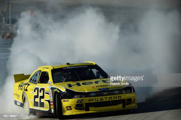Joey Logano driver of the Hertz Ford celebrates with a burnout after winning during the NASCAR Nationwide Series 5Hour Energy 200 Benefiting Living...