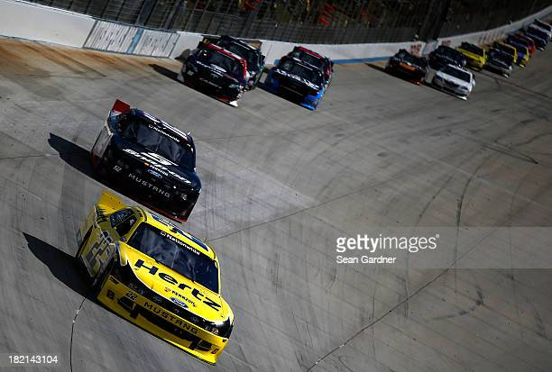 Joey Logano driver of the Hertz Ford leads a pack of cars during the NASCAR Nationwide Series 5Hour Energy 200 Benefiting Living Beyond Breast Cancer...