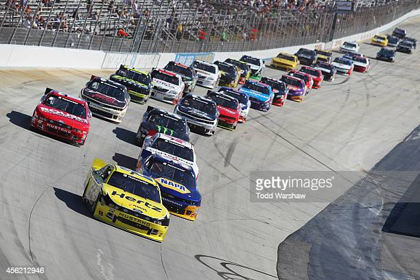 Joey Logano driver of the Hertz Ford leads a restart during the NASCAR Nationwide Series Dover 200 at Dover International Speedway on September 27...