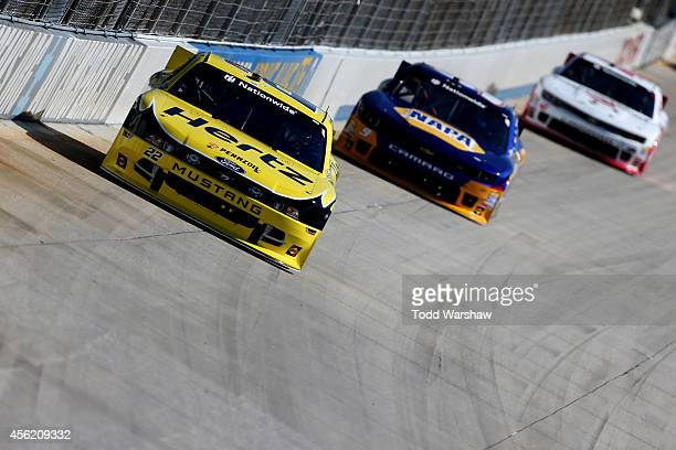 Joey Logano driver of the Hertz Ford leads Chase Elliott driver of the NAPA Auto Parts Chevrolet and Kyle Larson driver of the Cartwheel by Target...