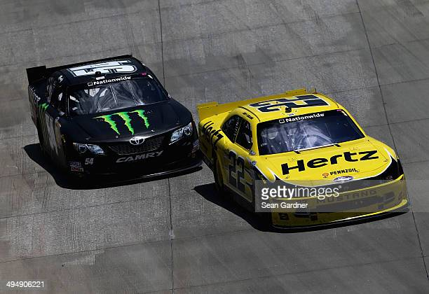 Joey Logano driver of the Hertz Ford leads Kyle Busch driver of the Monster Energy Toyota during the NASCAR Nationwide Series Buckle Up 200 Presented...
