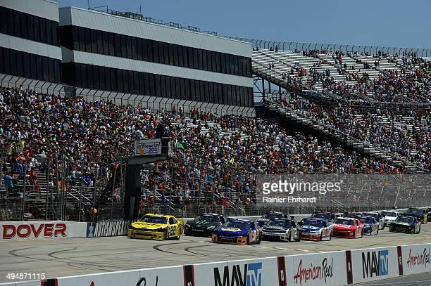 Joey Logano driver of the Hertz Ford leads the field to the green flag for the start of the NASCAR Nationwide Series Buckle Up 200 Presented By Click...