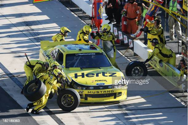 Joey Logano driver of the Hertz Ford pits during the NASCAR Nationwide Series 5Hour Energy 200 Benefiting Living Beyond Breast Cancer at Dover...