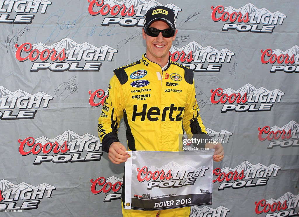 Joey Logano, driver of the #22 Hertz Ford, poses with the pole award after qualifying for the NASCAR Nationwide Series 5-Hour Energy 200 Benefiting Living Beyond Breast Cancer at Dover International Speedway on September 28, 2013 in Dover, Delaware.