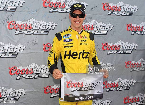 Joey Logano driver of the Hertz Ford poses with the pole award after qualifying for the NASCAR Nationwide Series 5Hour Energy 200 Benefiting Living...