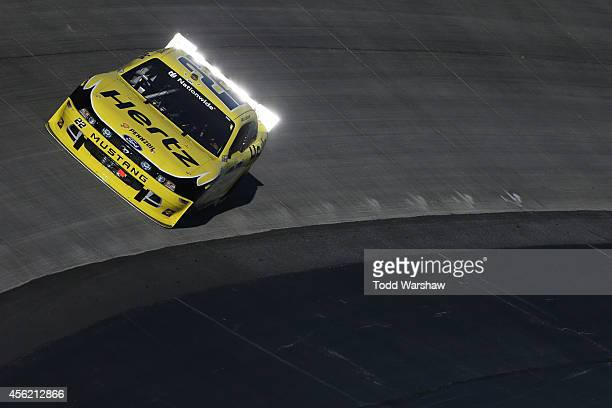 Joey Logano driver of the Hertz Ford races during the NASCAR Nationwide Series Dover 200 at Dover International Speedway on September 27 2014 in...