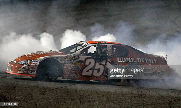 Joey Logano driver of the Hoe Depot Toyota celebrates his win during the NASCAR Toyota AllStar Showdow at Toyota Speedway on January 30 2010 in...