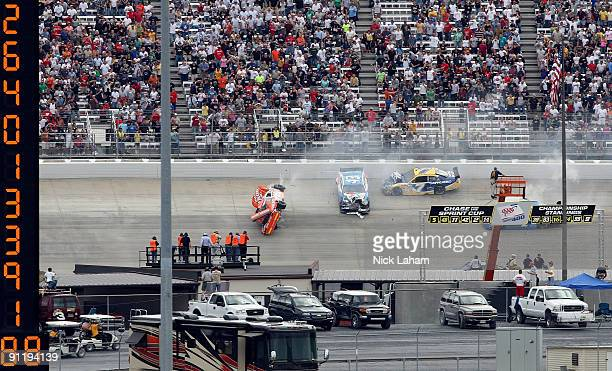 Joey Logano driver of the Home Depot Toyota flips his car after he was involved in a wreck with Reed Sorenson driver of the Valvoline Dodge Robby...