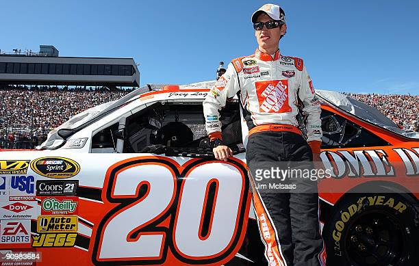 Joey Logano driver of the Home Depot Toyota looks from on the grid prior to the NASCAR Sprint Cup Series Sylvania 300 at the New Hampshire Motor...