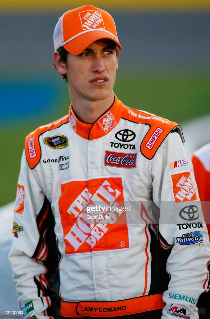 Joey Logano, driver of the #20 Home Depot Toyota looks on from the grid during qualifying for the NASCAR Sprint Cup Series Coca-Cola 600 at Charlotte Motor Speedway on May 27, 2010 in Concord, North Carolina.