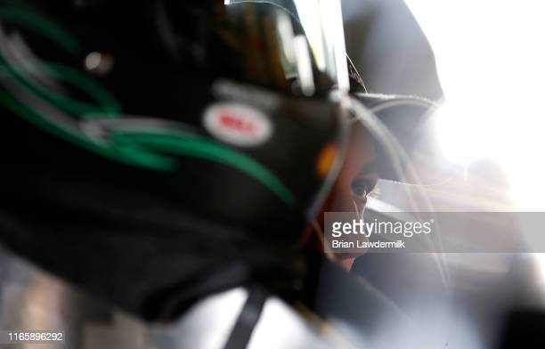 Joey Logano, driver of the MoneyLion Ford, sits in his car during practice for the Monster Energy NASCAR Cup Series Go Bowling at The Glen at Watkins...