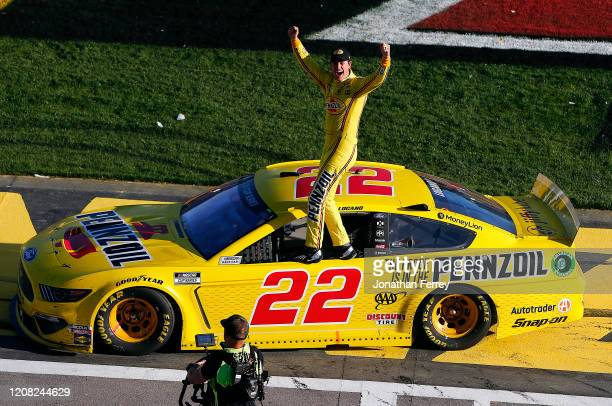 Joey Logano, driver of the Pennzoil Ford, celebrates his win during the NASCAR Cup Series Pennzoil 400 at Las Vegas Motor Speedway on February 23,...
