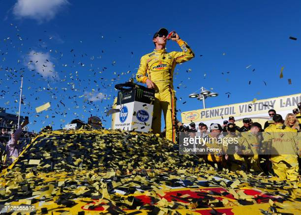 Joey Logano driver of the Pennzoil Ford celebrates in Victory Lane after winning the Monster Energy NASCAR Cup Series Pennzoil Oil 400 at Las Vegas...