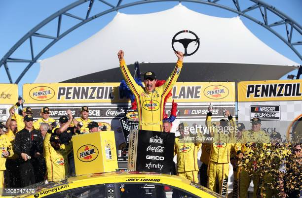 Joey Logano, driver of the Pennzoil Ford, celebrates in Victory Lane after winning the NASCAR Cup Series Pennzoil 400 at Las Vegas Motor Speedway on...