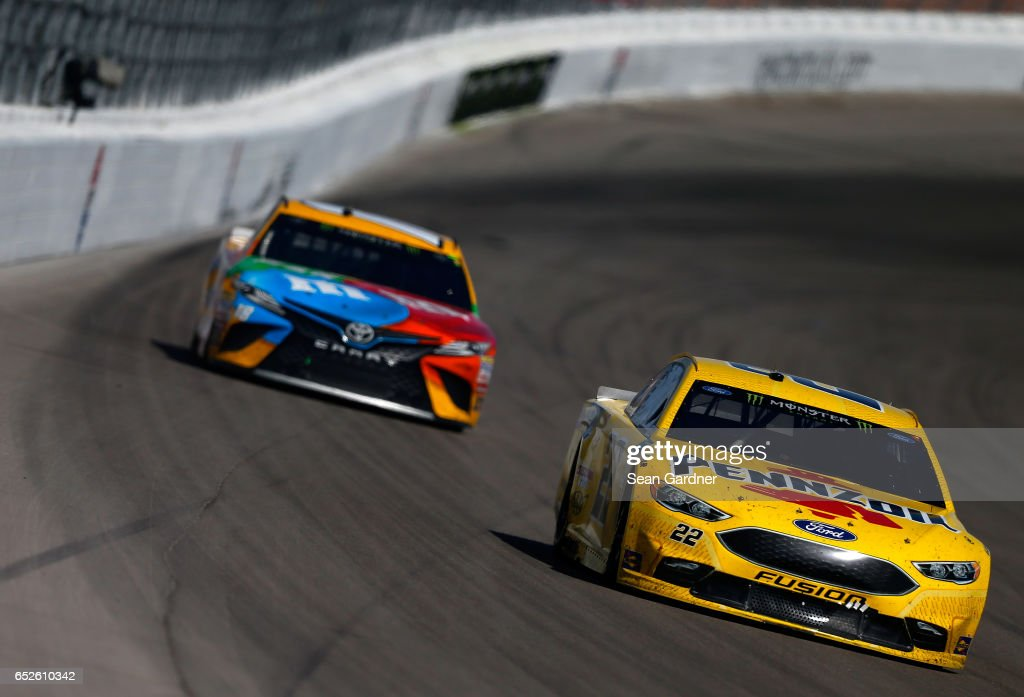 Joey Logano, driver of the #22 Pennzoil Ford, leads Kyle Busch, driver of the #18 M&M's Toyota, during the Monster Energy NASCAR Cup Series Kobalt 400 at Las Vegas Motor Speedway on March 12, 2017 in Las Vegas, Nevada.