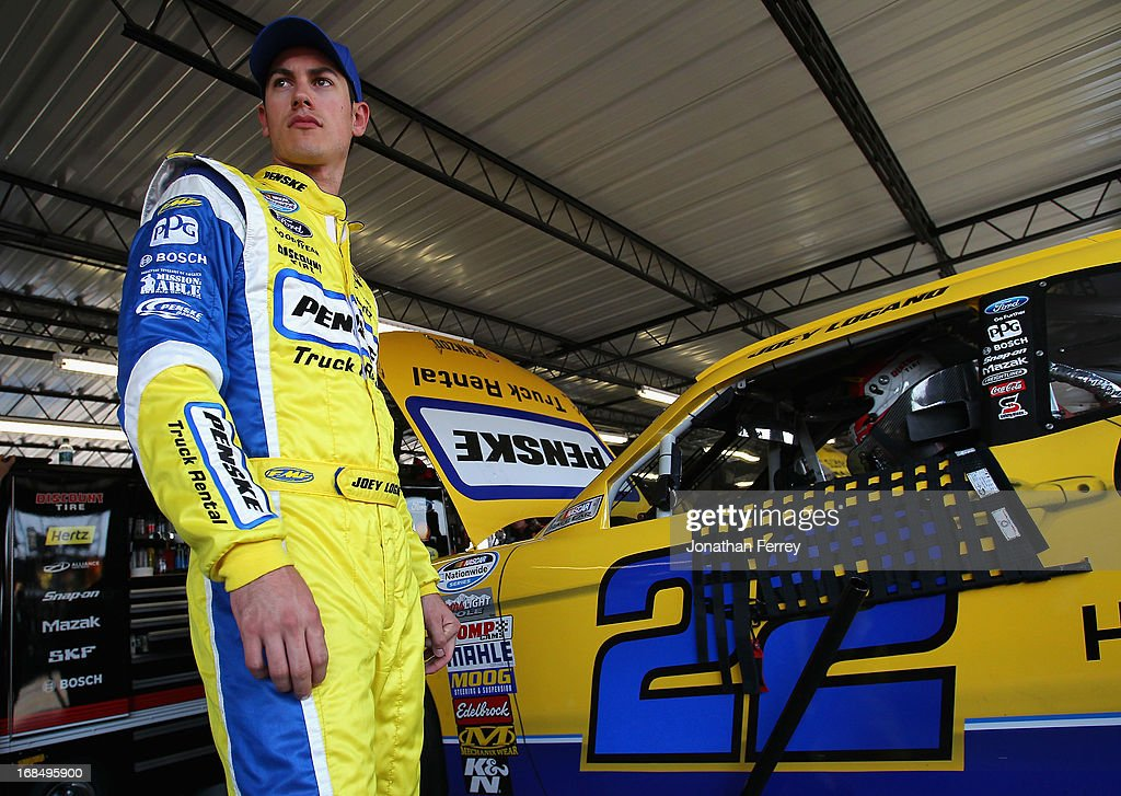 Joey Logano, driver of the #22 Penske Truck Rental Ford, looks on in the garage during practice for the NASCAR Nationwide Series VFW Sport Clips Hero 200 at Darlington Raceway on May 10, 2013 in Darlington, South Carolina.