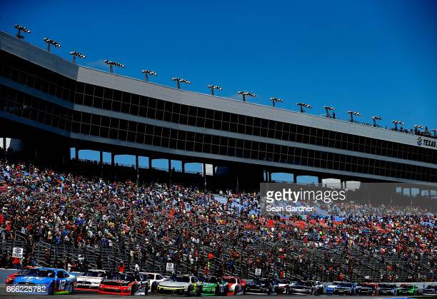 Joey Logano driver of the PPG Ford leads the field at the start of the NASCAR XFINITY Series My Bariatric Solutions 300 at Texas Motor Speedway on...