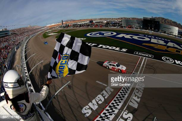 Joey Logano driver of the REV Ford takes the checkered flag to win the NASCAR XFINITY Series Boyd Gaming 300 at Las Vegas Motor Speedway on March 11...