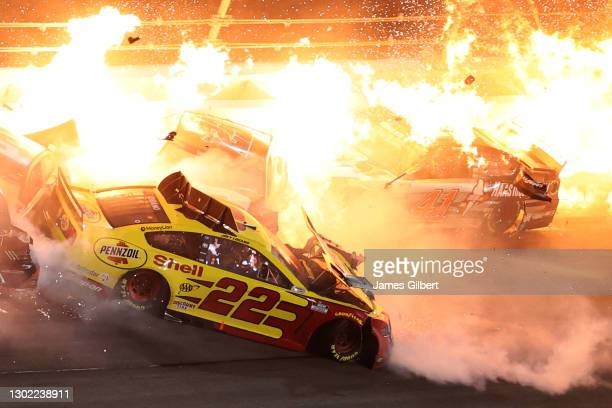 Joey Logano, driver of the Shell Pennzoil Ford, and Cole Custer, driver of the HaasTooling.com Ford, are involved in an on-track incident during the...
