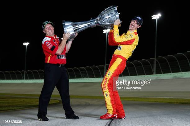 Joey Logano driver of the Shell Pennzoil Ford and crew chief Todd Gordon pose for a photo after winning the Monster Energy NASCAR Cup Series Ford...