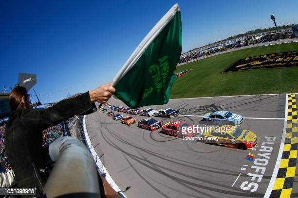 Joey Logano, driver of the Shell Pennzoil Ford, and Kevin Harvick, driver of the Busch Light Ford, lead the field at the start of the Monster Energy...